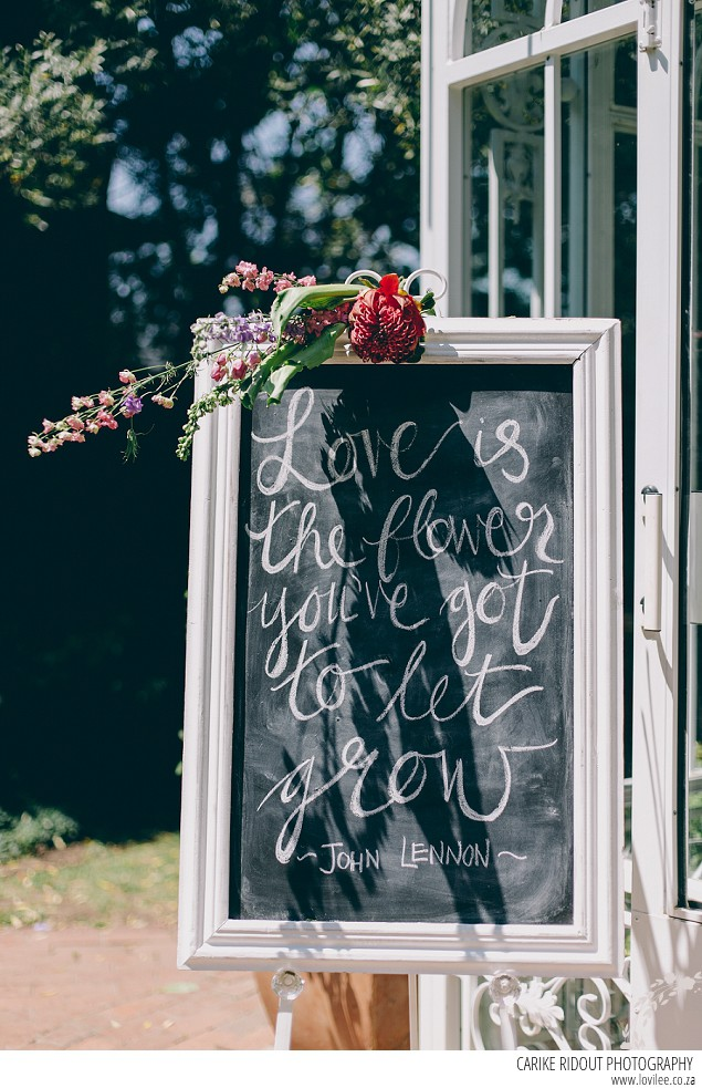 Wedding welcome sign on a black board with hand-lettering