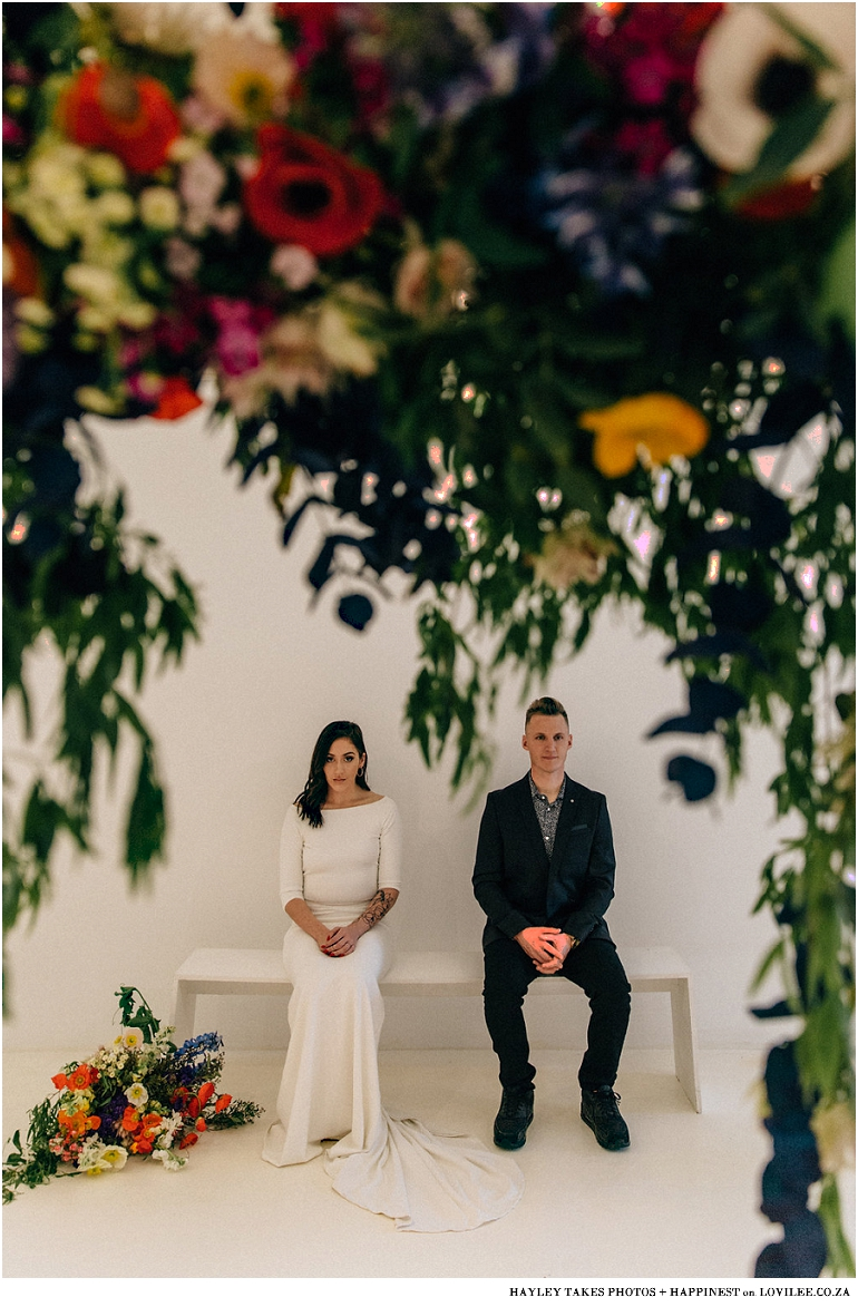 Wedding couple portrait with large colourburst bouquet