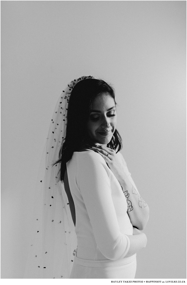 Black and white bridal portrait with confetti veil