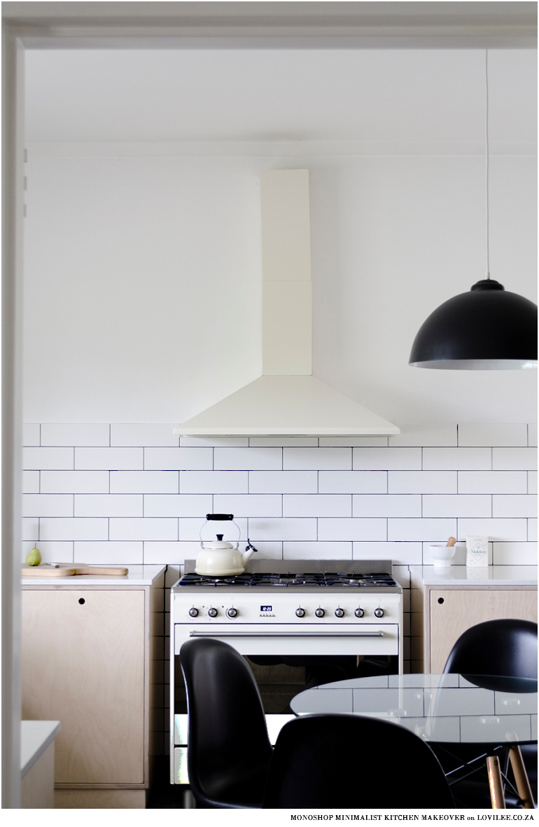 Minimalist kitchen makeover with off-shite smeg over and extractor