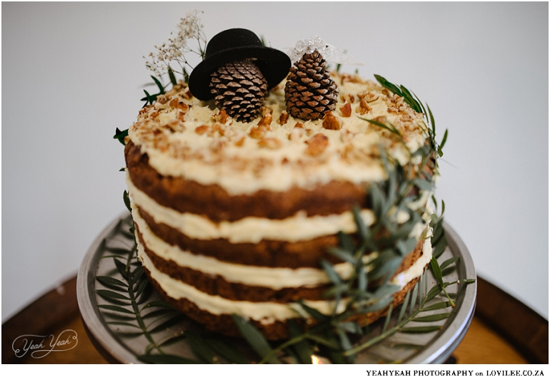 Wedding cake with pine cone toppers