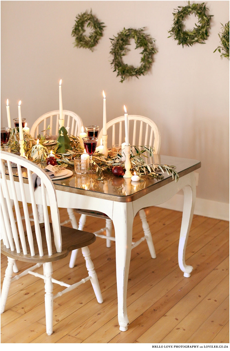 Scandinavian Christmas table decoration with olivebranches