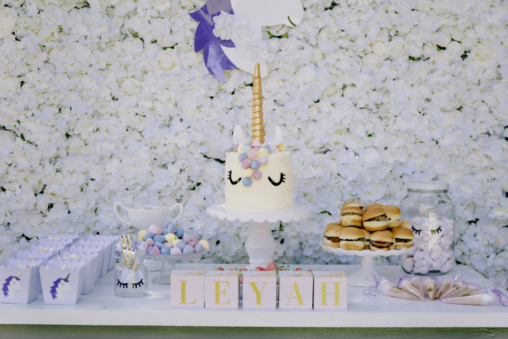 Unicorn Party candy table and unicorn cake