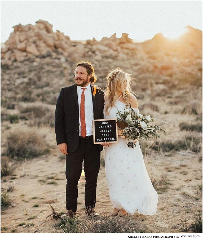 Wedding couple with letterboard by Chelsey Marras Photography
